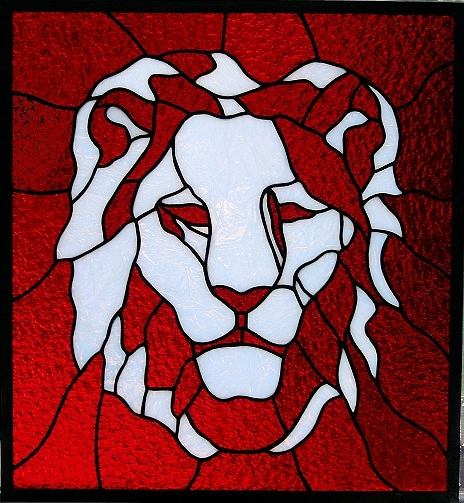 Lion head stained glass panel