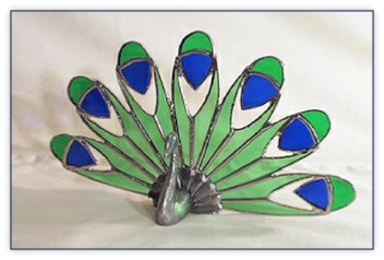 peacock figure with stained glass tail
