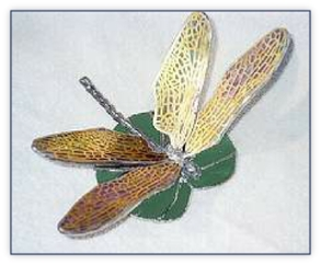 dragonfly with brass wings on lily pad
