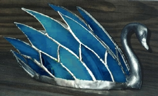 swan figure with glass feathers